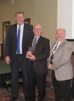 <p>WLACC President Ken Warner (left) and Chamber Board Chair Brad Hanson (right) present &nbsp;Dr. Dale Lauer (MN Poultry Testing Laboratory) with the 2015 Exemplary Leadership Award</p>