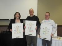 <p>Retiring Board of Directors receive their caricatures as a &ldquo;Thank You&rdquo; for their service to the Chamber.&nbsp; L to R is Jeanne Ashburn (Edward Jones), Randy Czarnetzki (Hardware Hank Express) and Bert Hansen (Hansen Advertising)</p>